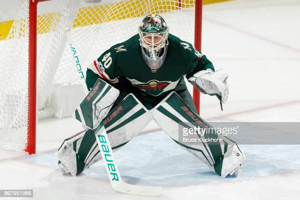 Devan Dubnyk of the Minnesota Wild defends his goal against the New York Islanders during the game at the Xcel Energy Center on October 26 2017 in St...