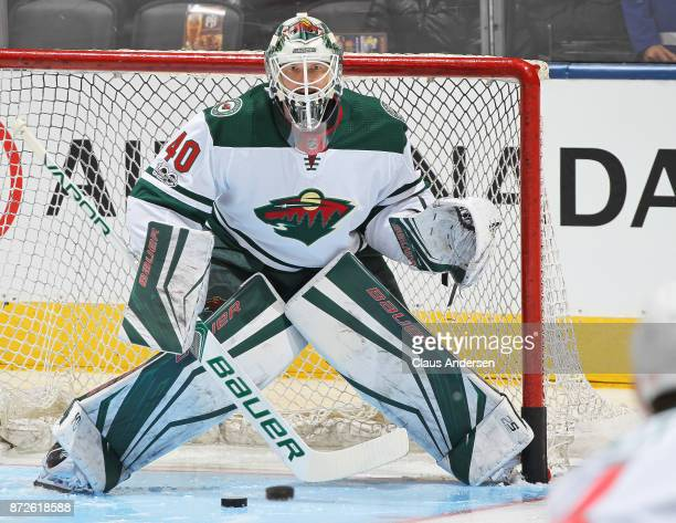 Devan Dubnyk of the Minnesota Wild faces a shot during the warmup prior to playing against the Toronto Maple Leafs in an NHL game at the Air Canada...