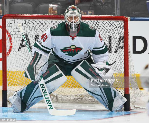 Devan Dubnyk of the Minnesota Wild faces a shot in the warmup prior to action against the Toronto Maple Leafs in an NHL game at the Air Canada Centre...
