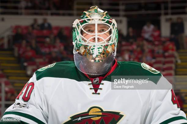 Devan Dubnyk of the Minnesota Wild looks down the ice before the start of an NHL game against the Detroit Red Wings at Joe Louis Arena on March 26...