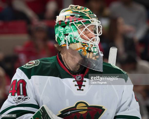 Devan Dubnyk of the Minnesota Wild looks down the ice during an NHL game against the Detroit Red Wings at Joe Louis Arena on March 26 2017 in Detroit...