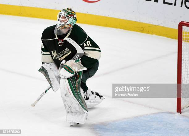 Devan Dubnyk of the Minnesota Wild looks on after an overtime loss against the St Louis Blues in Game Five of the Western Conference First Round...