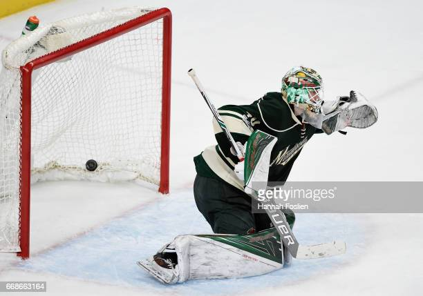 Devan Dubnyk of the Minnesota Wild looks on as a shot by Jaden Schwartz of the St Louis Blues hits the net to score a goal during the third period in...