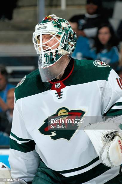 Devan Dubnyk of the Minnesota Wild looks on during a NHL game against the San Jose Sharks at SAP Center on April 7 2018 in San Jose California Devan...