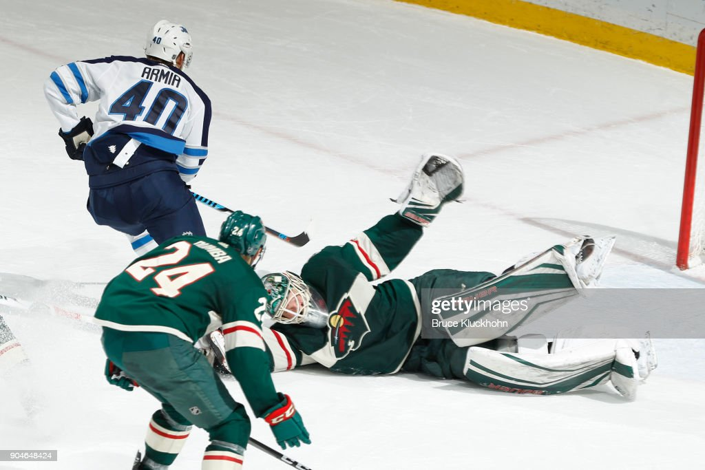 Devan Dubnyk #40 of the Minnesota Wild makes a save against Joel Armia #40 of the Winnipeg Jets during the game at the Xcel Energy Center on January 13, 2018 in St. Paul, Minnesota.