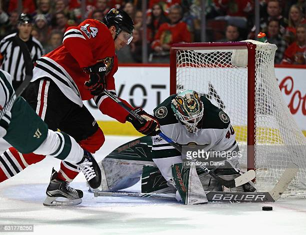 Devan Dubnyk of the Minnesota Wild makes a save against Richard Panik of the Chicago Blackhawks at the United Center on January 15 2017 in Chicago...
