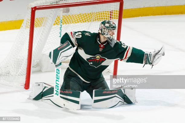 Devan Dubnyk of the Minnesota Wild makes a save against the Nashville Predators during the game at the Xcel Energy Center on November 16 2017 in St...