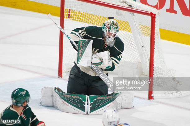 Devan Dubnyk of the Minnesota Wild makes a save against the St Louis Blues in Game One of the Western Conference First Round during the 2017 NHL...