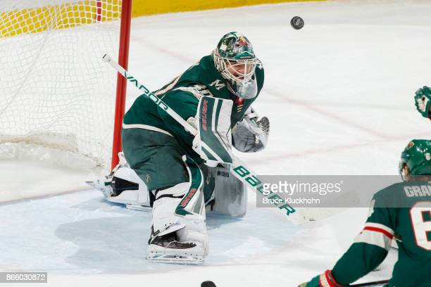 Devan Dubnyk of the Minnesota Wild makes a save against the Vancouver Canucks during the game at the Xcel Energy Center on October 24 2017 in St Paul...