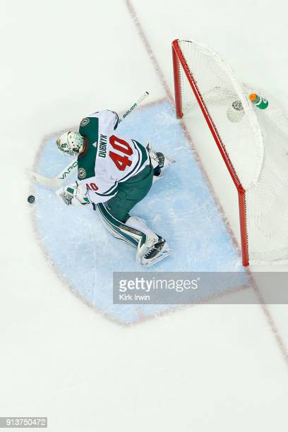 Devan Dubnyk of the Minnesota Wild makes a save during the game against the Columbus Blue Jackets on January 30 2018 at Nationwide Arena in Columbus...