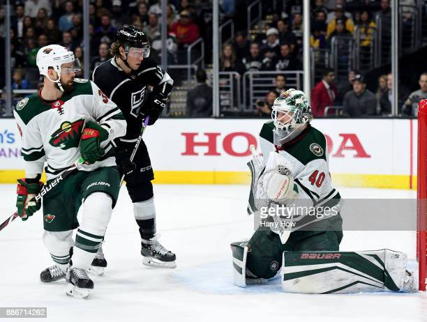 Devan Dubnyk of the Minnesota Wild makes a save in front of Tyler Toffoli of the Los Angeles Kings and Nate Prosser during the second period at...