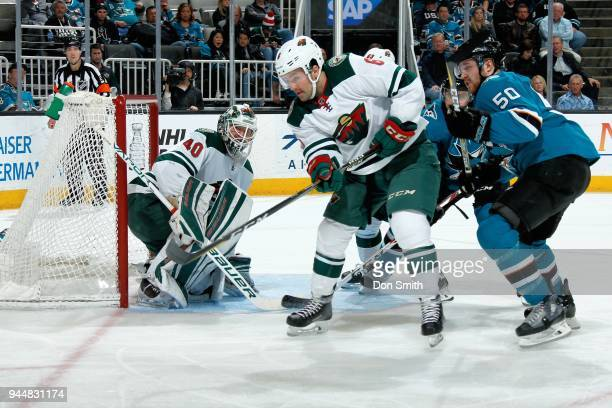 Devan Dubnyk of the Minnesota Wild protects the net as Ryan Murphy of the Minnesota Wild defends Chris Tierney of the San Jose Sharks at SAP Center...