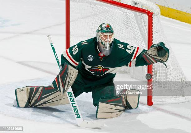 Devan Dubnyk of the Minnesota Wild reaches out to make a glove save during a game with the New Jersey Devils at Xcel Energy Center on February 15...
