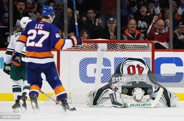 Devan Dubnyk of the Minnesota Wild reacts after allowing a secondperiod goal to Tanner Fritz of the New York Islanders as Anders Lee celebrates at...