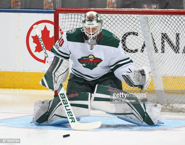 Devan Dubnyk of the Minnesota Wild stops shots during the warmup prior to action against the Toronto Maple Leafs in an NHL game at the Air Canada...