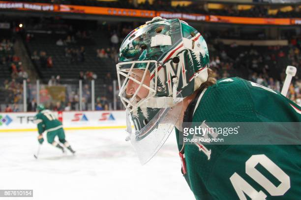 Devan Dubnyk of the Minnesota Wild warms up prior to the game against the Pittsburgh Penguins at the Xcel Energy Center on October 28 2017 in St Paul...