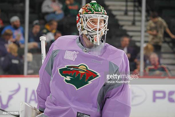 Devan Dubnyk of the Minnesota Wild wears a lavender jersey for Hockey Fights Cancer Awareness Night during warmups prior to the game against the...