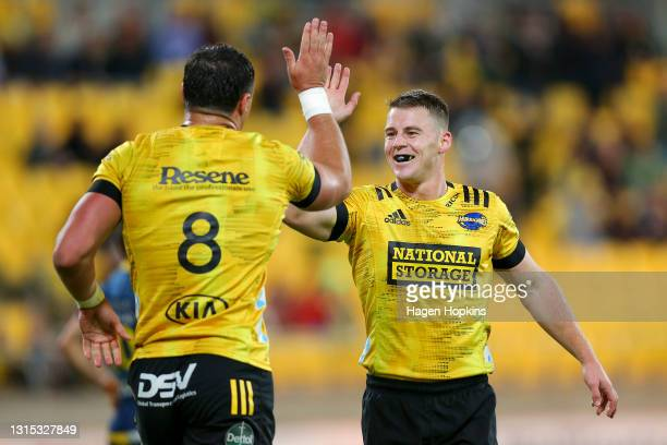 Devan Flanders of the Hurricanes with Luke Campbell celebrates after scoring a try during the round 10 Super Rugby Aotearoa match between the...