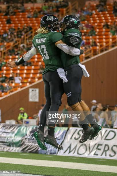 Devan Stubblefield and Cole McDonald of the Hawaii Rainbow Warriors celebrate after connecting on a touchdown pass during the third quarter of the...