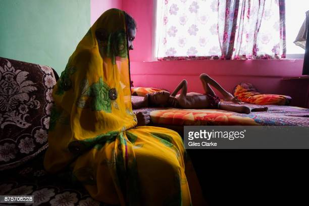 Devank 8 years old with his mother Sunita at home in the Risaldar Colony neighborhood Devank was born to parents contaminated by a carcinogenic and...