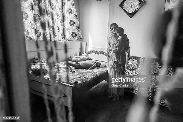 Devank Sahu 8 years old with his mother Sunita Sahu at home in the Risaldar Colony neighborhood Devank was born to parents contaminated by a...