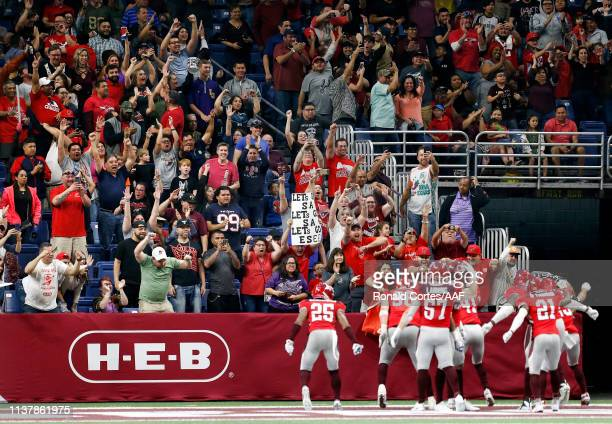 De'Vante Bausby of San Antonio Commanders celebrates his touchdown with teammates and fans late in the fourth quarter of the Alliance of American...