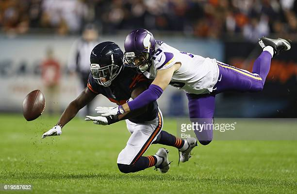 De'Vante Bausby of the Chicago Bears breaks up a pass intended for Adam Thielen of the Minnesota Vikings during the first half of their game at...