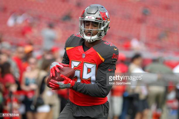 Devante Bond of the Bucs warms up before the regular season game between the New York Jets and the Tampa Bay Buccaneers on November 12, 2017 at...