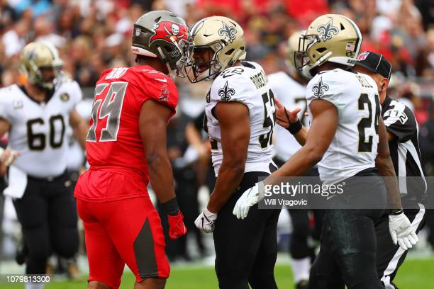 Devante Bond of the Tampa Bay Buccaneers and A.J. Klein of the New Orleans Saints get in each other's face during the second quarter at Raymond James...