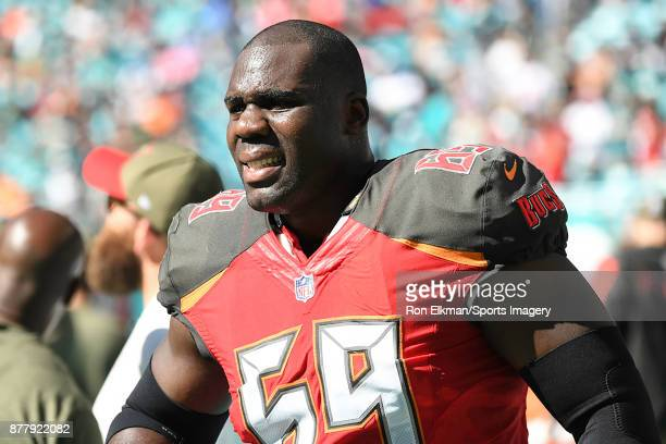 Devante Bond of the Tampa Bay Buccaneers looks on before a NFL game against the Miami Dolphins at Hard Rock Stadium on November 19, 2017 in Miami...