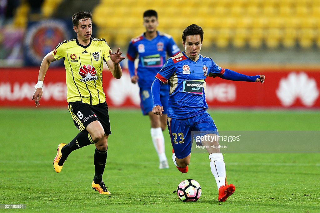 Devante Clut of the Jets is challenged by Alex Rodriguez of the Phoenix during the round five A-League match between the Wellington Phoenix and the Newcastle Jets at Westpac Stadium on November 5, 2016 in Wellington, New Zealand.