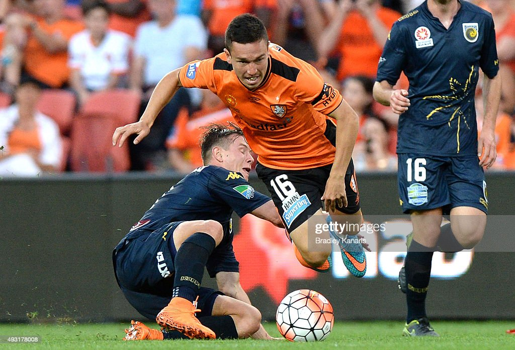 Devante Clut of the Roar is tackled during the round two A-League match between the Brisbane Roar and Central Coast Mariners at Suncorp Stadium on October 18, 2015 in Brisbane, Australia.
