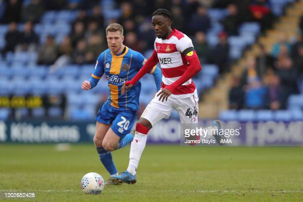 Devante Cole of Doncaster Rovers and Josh Vela of Shrewsbury Town during the Sky Bet League One match between Shrewsbury Town and Doncaster Rovers at...
