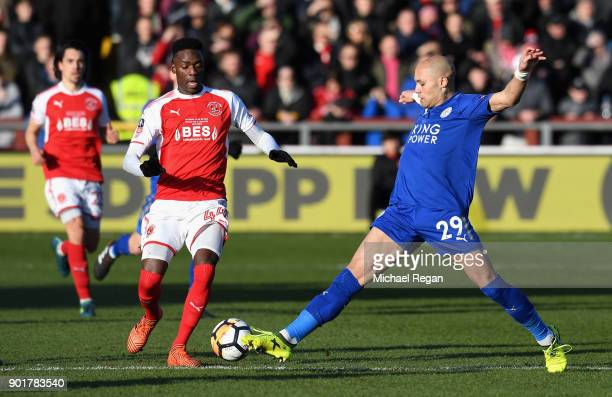 Devante Cole of Fleetwood Town and Yohan Benalouane of Leicester City in action during the The Emirates FA Cup Third Round match between Fleetwood...