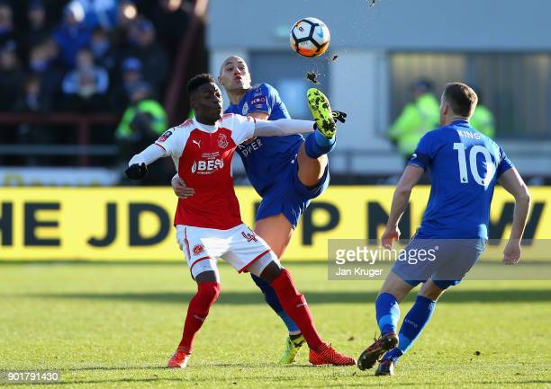 Devante Cole of Fleetwood Town and Yohan Benalouane of Leicester City battle for the ball during the The Emirates FA Cup Third Round match between...