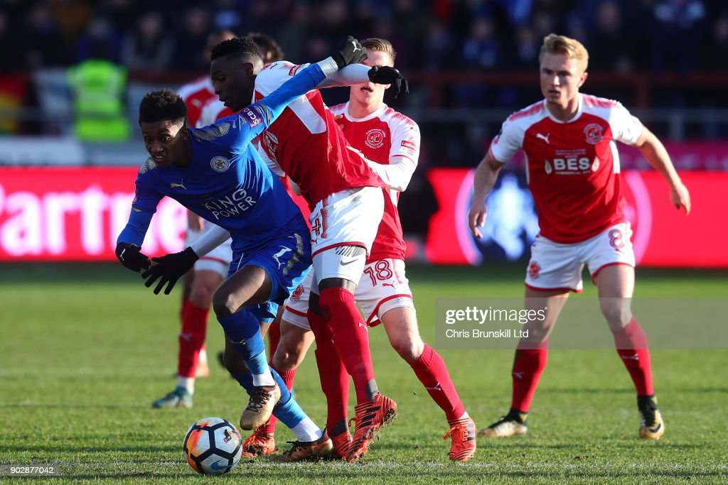Devante Cole of Fleetwood Town in action with Demarari Gray of Leicester City during The Emirates FA Cup Third Round match between Fleetwood Town and Leicester City at Highbury Stadium on January 6, 2018 in Fleetwood, England.