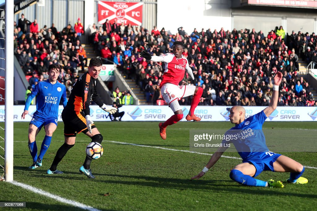 Devante Cole of Fleetwood Town in action with Eldin Jakupovic (C) of Leicester City during The Emirates FA Cup Third Round match between Fleetwood Town and Leicester City at Highbury Stadium on January 6, 2018 in Fleetwood, England.