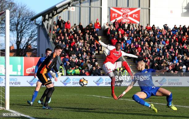 Devante Cole of Fleetwood Town sees a shot deflect off Yohan Benalouane of Leicester City towards goal during The Emirates FA Cup third round match...