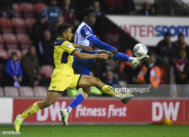 Devante Cole of Wigan and Curtis Nelson of Oxford in action during the Sky Bet League One match between Wigan Athletic and Oxford United at DW...