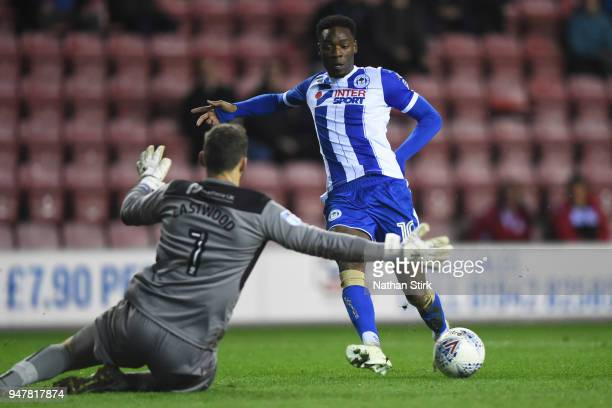 Devante Cole of Wigan Athletic squares the ball through to Will Grigg who goes to score during the Sky Bet League One match between Wigan Athletic...