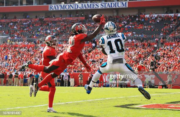 De'Vante Harris of the Tampa Bay Buccaneers breaks up a pass intended for Curtis Samuel of the Carolina Panthers during the second quarter at Raymond...