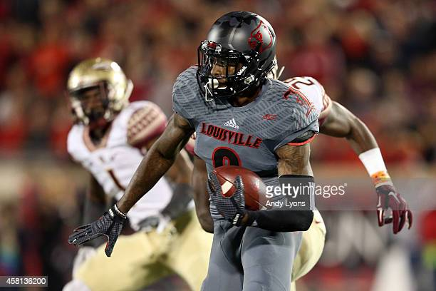DeVante Parker of the Louisville Cardinals catches a 51 yard pass in the fourth quarter thrown by Will Gardner against the Florida State Seminoles...