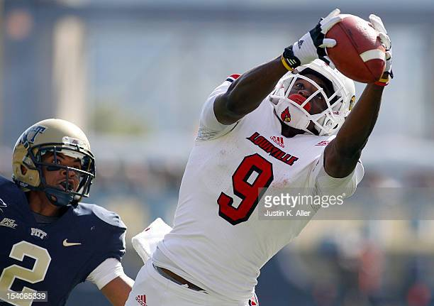 DeVante Parker of the Louisville Cardinals makes a catch in the second half against the Pittsburgh Panthers during the game on October 13 2012 at...
