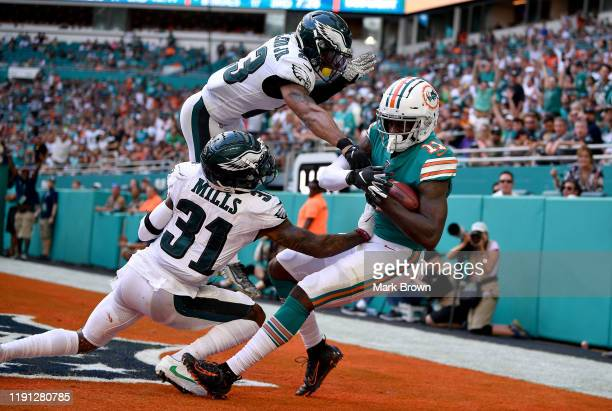 DeVante Parker of the Miami Dolphins catches a touchdown against the Philadelphia Eagles in the third quarter at Hard Rock Stadium on December 01...