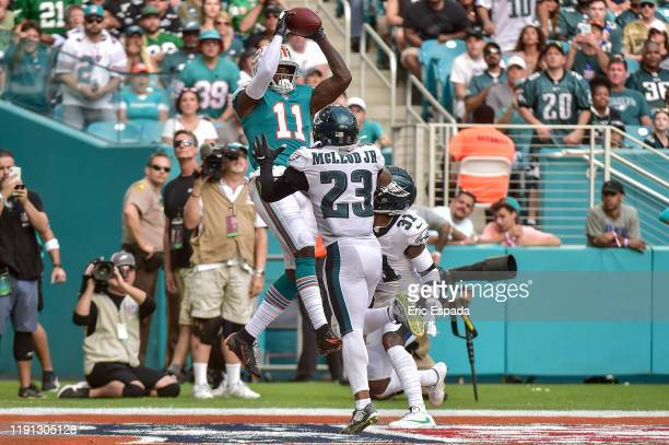 DeVante Parker of the Miami Dolphins catches a touchdown in the third quarter against the Philadelphia Eagles at Hard Rock Stadium on December 01...