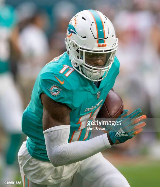 DeVante Parker of the Miami Dolphins catches the ball in warmups before a preseason game against the Tampa Bay Buccaneers at Hard Rock Stadium on...