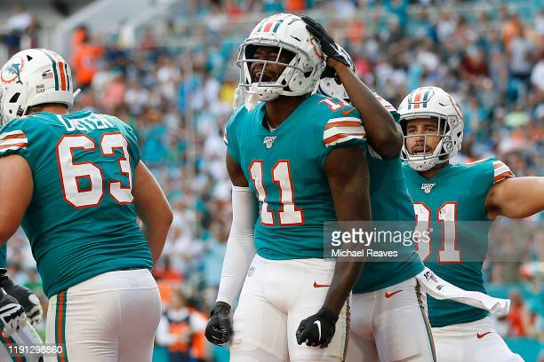 DeVante Parker of the Miami Dolphins celebrates after a touchdown against the Philadelphia Eagles at Hard Rock Stadium on December 01 2019 in Miami...
