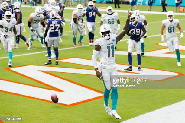 DeVante Parker of the Miami Dolphins celebrates after a touchdown reception against the Buffalo Bills during the first half at Hard Rock Stadium on...