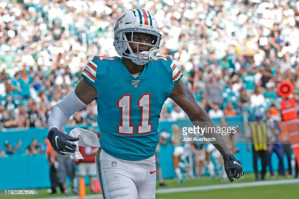 DeVante Parker of the Miami Dolphins celebrates after scoring a touchdown against the Philadelphia Eagles during an NFL game on December 1 2019 at...