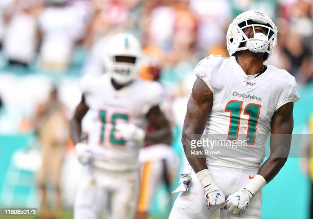 DeVante Parker of the Miami Dolphins celebrates scoring a touchdown against the Washington Redskins in the fourth quarter at Hard Rock Stadium on...